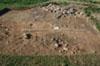 Teolin, gm. Janów, stan. 1. Odsłonięta kamienna konstrukcja nasypu kurhanu nr 1, lipiec 2010 r. Fot. I. Kryński