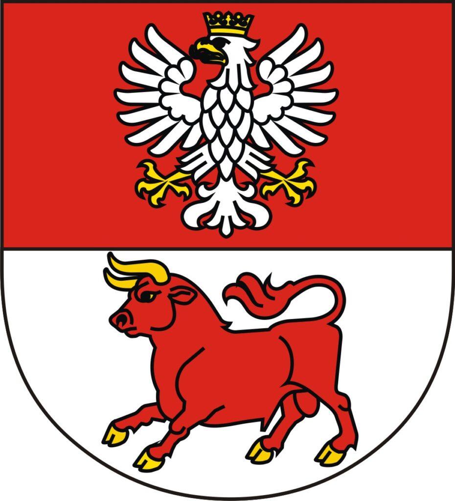 Herb Powiatu Bielskiego, tarcza dwudzielna w pas, w polu górnym, czerwonym orzeł, w polu dolnym, srebrnym czerwony tur