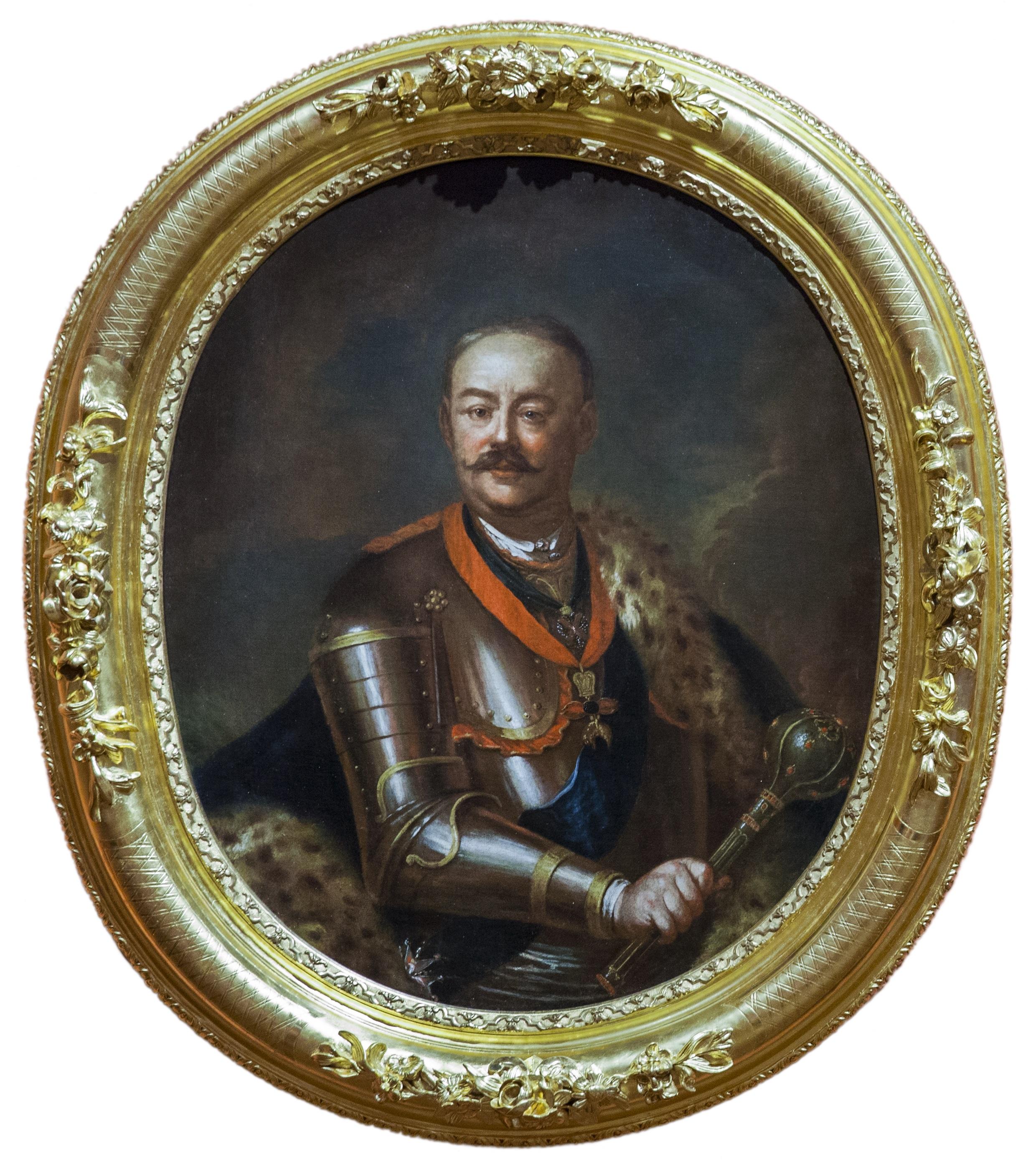Na owalnym obrazie w pozłacanej ramie widać postać mężczyzny w średnim wieku, hetmana Jana Klemensa Branickiego w zbroi, z buławą w ręku.
